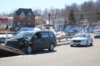 The driver of a Quinn's Marine and Machine Shop service van was ticketed for a minor violation of the Highway Traffic Act after colliding with a car on Main Street, Montague Tuesday morning, according to Kings District RCMP Sergeant Chris Gunn. The drivers were the only occupants of the two vehicles involved and neither was injured.