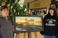 Shirley Brown-Jenkins, left, and Charlene MacPhee of Montague were selling raffle tickets on a piece of artwork at the Down East Mall in Montague last Thursday. Proceeds from the ticket sales will go to Cathy Weir, from Souris, who fell in November and must travel to Charlottetown for physiotherapy five days a week.
